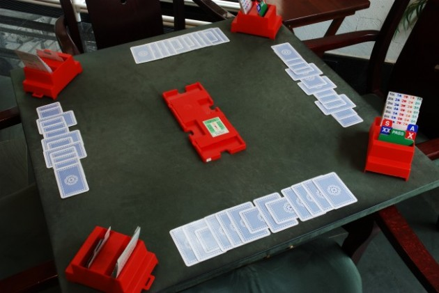 Bridge_played_cards_after_game-630x421